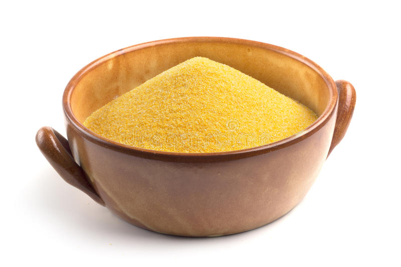 Cornmeal in bowl. Isolated on white background stock photography