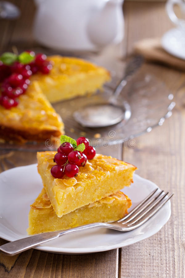 Cornmeal cake with berries. Gluten free cornmeal cake served with red currant stock image