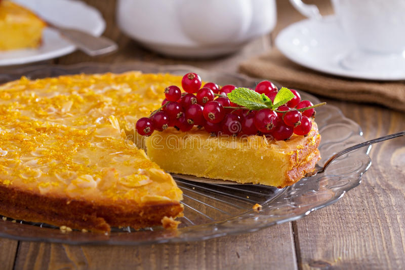 Cornmeal cake with berries. Gluten free cornmeal cake served with red currant stock photo