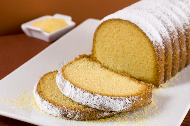 Cornmeal cake. Slices of cornmeal cake and ingredients stock image