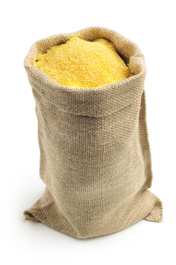 Cornmeal. Canvas bag with cornmeal isolated on white background royalty free stock photography