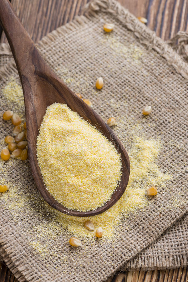 Cornmeal. Heap of fresh Cornmeal as detailed close-up shot royalty free stock photo