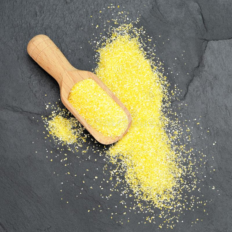 Cornmeal in wooden spoon. Top view of cornmeal in wooden spoon stock photography