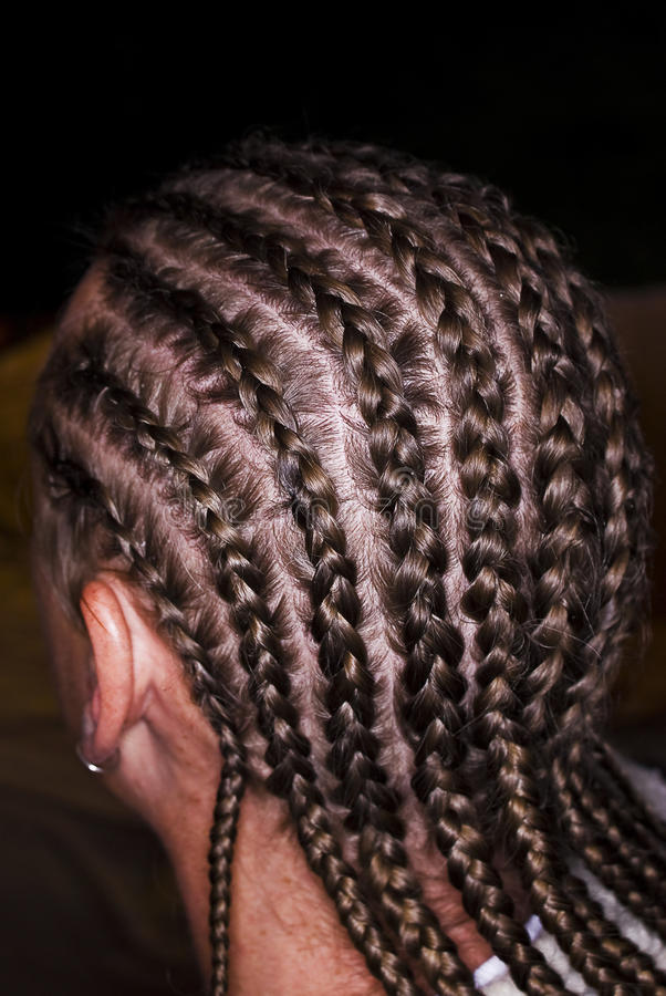 Cornrow Braids - Rear View. Male with cornrow braids. Back 3/4 view, opposite angle. Arrange or style hair by dividing into sections and braiding close to the stock images