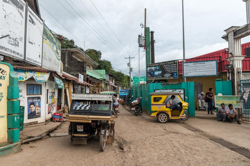 CORON, PHILIPPINES - JANUARY 28, 2018: Coron street with tricycle in Philippines royalty free stock images