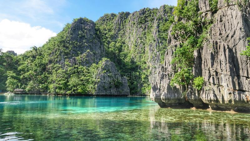 Coron Philippines Sea and Lime Stone Rock. With bright blue water stock images