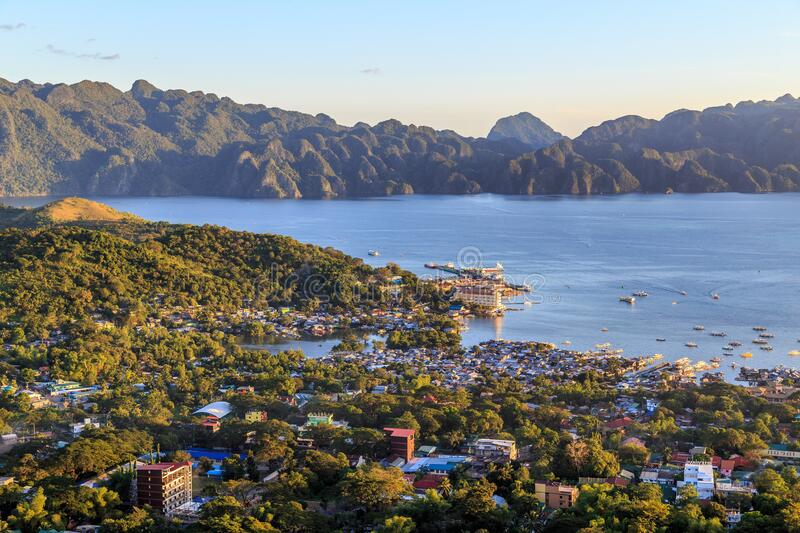Coron Town and Coron Island, Palawan. View from Mt. Tapyas over Coron Town, harbour and Coron Island with its rugged mountains and rainforest stock photo
