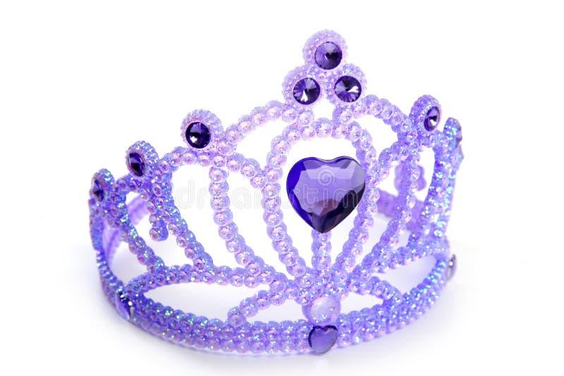 Corona azul púrpura de los niños con la gema plástica imágenes de archivo libres de regalías