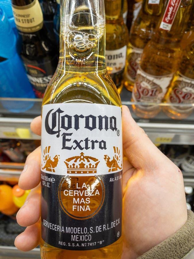 Corona Beer. Belgrade, Serbia - April 04, 2020: Famous Mexican Corona Beer Bottle in Hand in Belgrade, Serbia royalty free stock photos