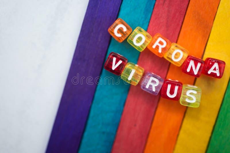 Corona virus. Colorful word CORONA VIRUS english alphabet cube on colourfull background, selective focus stock images