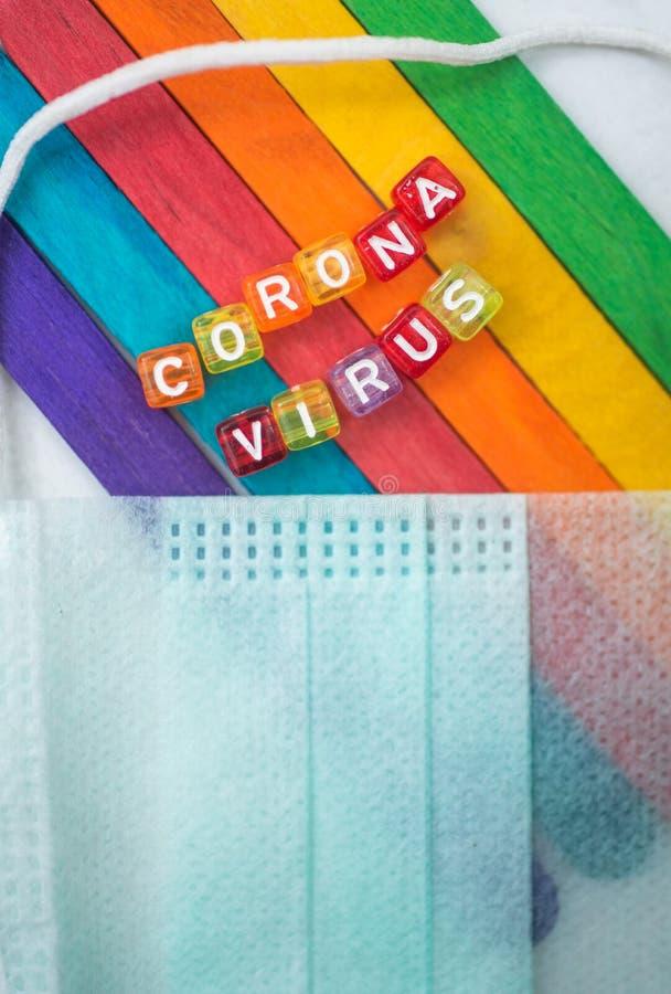 Corona virus. Colorful word CORONA VIRUS english alphabet cube on colourfull background, selective focus royalty free stock photography