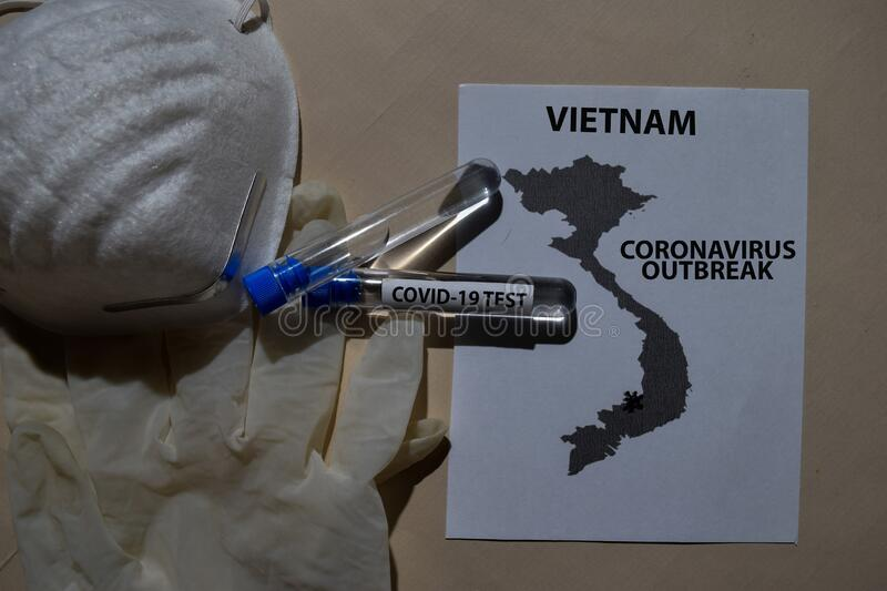 Corona Virus outbreak with Vietnam map printed on paperwork. Vaccine Covid-19 Test isolated on office desk. Awareness Prevention. Medical concept stock photo