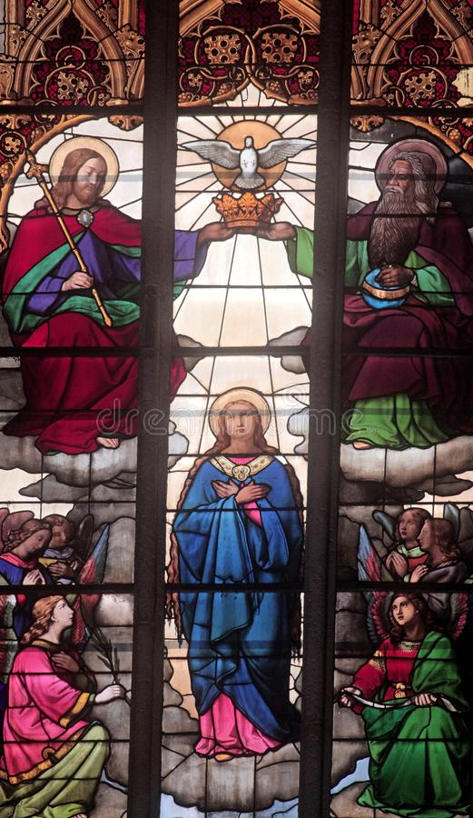 Coronation of the Blessed Virgin Mary. Stained glass window in Zagreb cathedral royalty free stock photography
