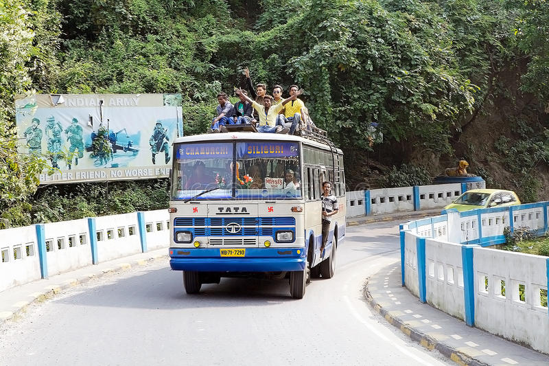 Coronation Bridge, West Bengal, India. Indian coach full of people is passing along the Coronation Bridge, also known as Sevoke, Bridge, Sevoke, West Bengal stock photo