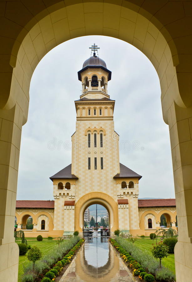 Coronation Cathedral in Alba Iulia. Bell Tower and entrance in courtyard of Coronation Cathedral in Alba Iulia known as Reunification Cathedral royalty free stock photography
