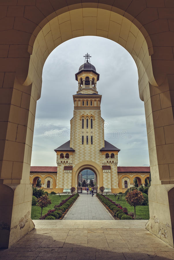 Coronation Cathedral Bell Tower, Alba Iulia, Romania. Alba Iulia, Romania - May 06, 2015: Bell tower of the Coronation Cathedral, dedicated to the Holy Trinity stock images