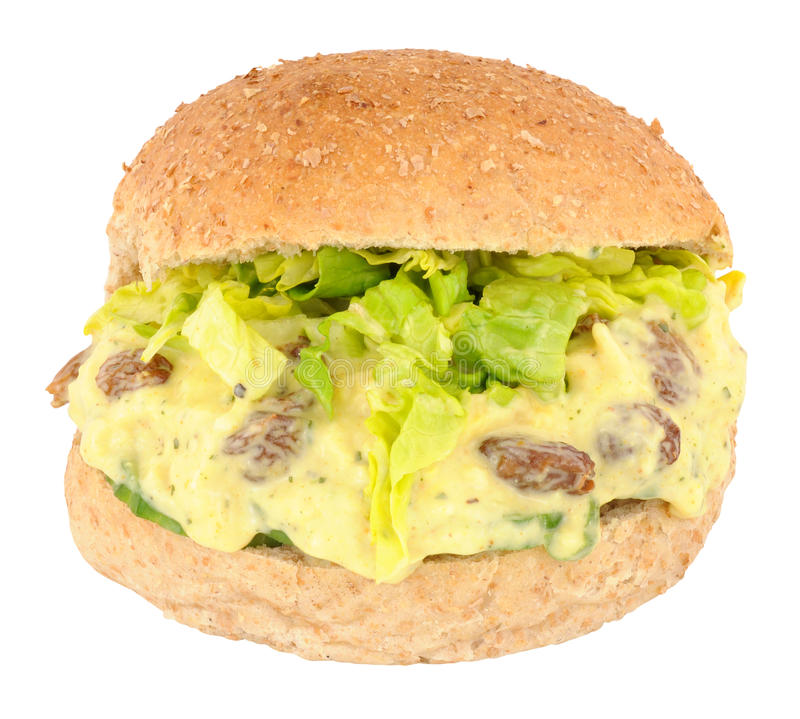 Coronation Chicken Sandwich Roll. Coronation chicken filled sandwich bread roll isolated on a white background stock photo