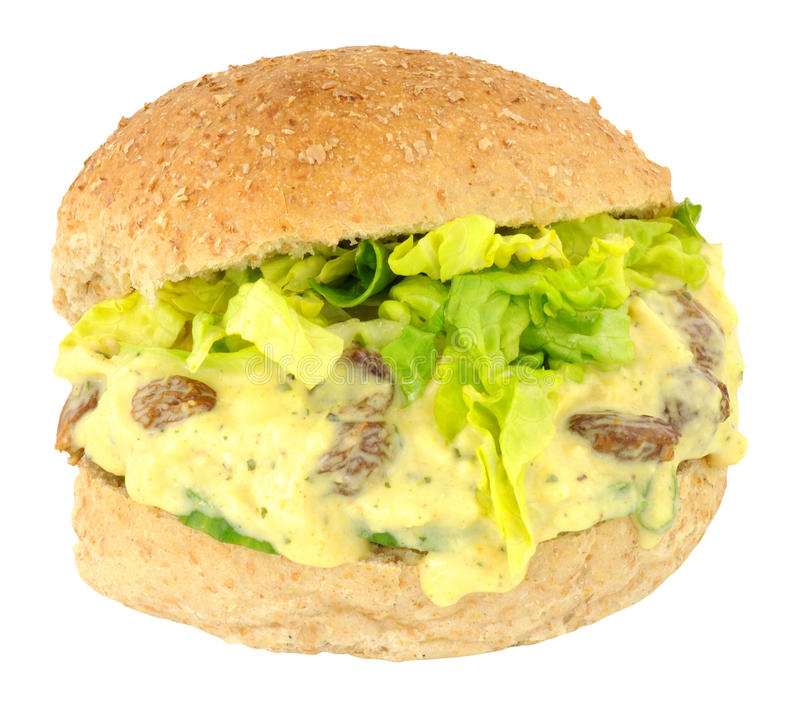 Coronation Chicken Sandwich Roll. Coronation chicken filled sandwich bread roll isolated on a white background royalty free stock image