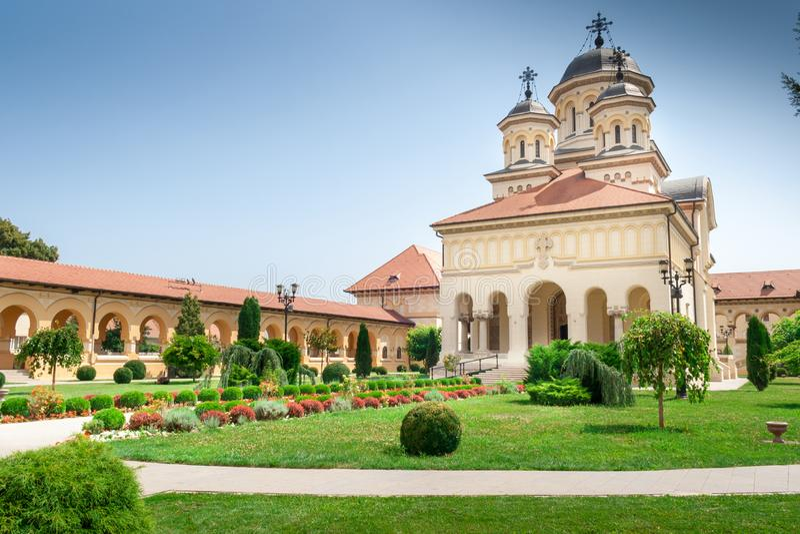 The Coronation Orthodox Cathedral inside Fortress of Alba Iulia, Transylvania, Romania. Beautiful garden around The Coronation Orthodox Cathedral inside Fortress stock images