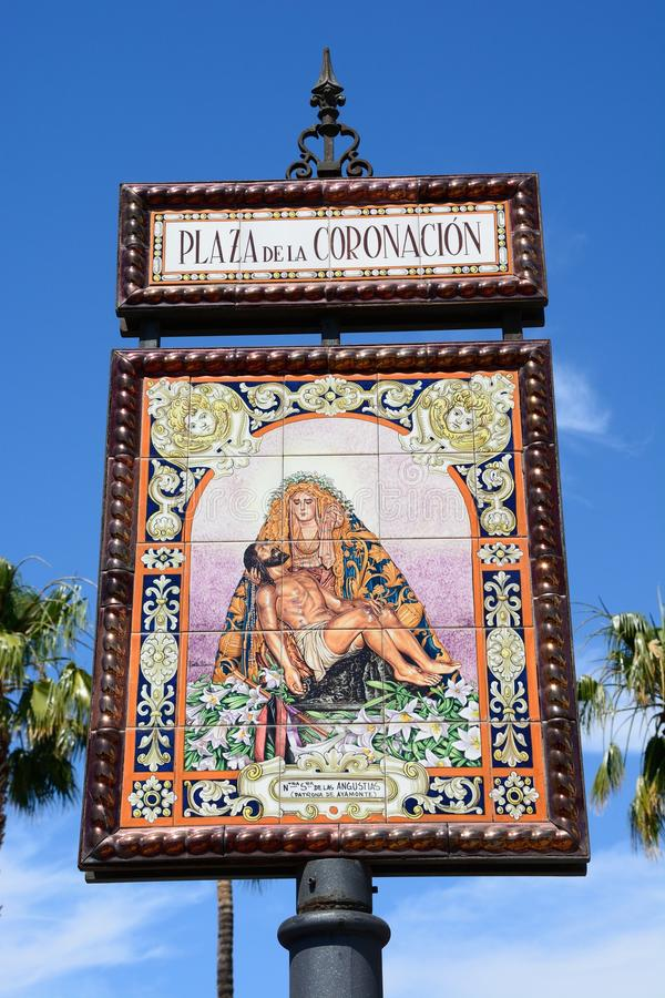 Coronation Square sign, Ayamonte. Ceramic sign depicting Mary holding the crucified Jesus, Coronation Square Plaza de la Coronacion, Ayamonte, Huelva Province stock photography