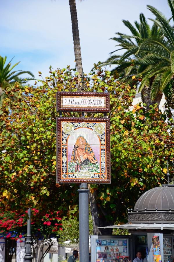Coronation Square sign, Ayamonte. Ceramic sign depicting Mary holding the crucified Jesus, Coronation Square Plaza de la Coronacion, Ayamonte, Huelva Province royalty free stock image