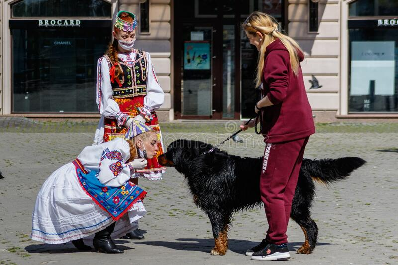Coronavirus disease 2019 COVID-19- Art mob on the occasion of the Day of embroidered shirt in Uzhgorod stock photos
