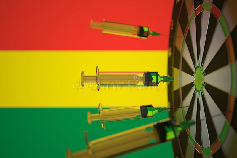 COVID-19 coronavirus disease vaccine syringes hit target against the Bolivian flag. Successful research and vaccination royalty free stock photo