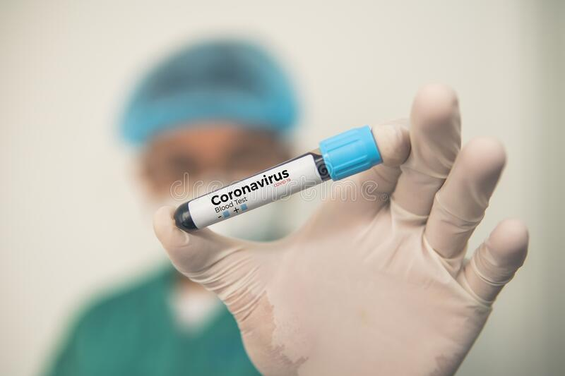 Coronavirus 2019-nCoV Blood Sample. Corona virus outbreaking. Corona Virus in Lab. Scientist hold a tube with Blood Test. And Barcode with the Virus Name royalty free stock photos