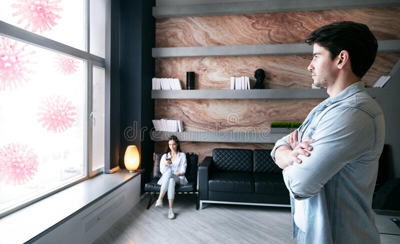 Coronavirus quarantine concept. Young man and woman stay safe and confidently about covid viruses outside. Stay at home. Coronavirus quarantine concept. Young stock image