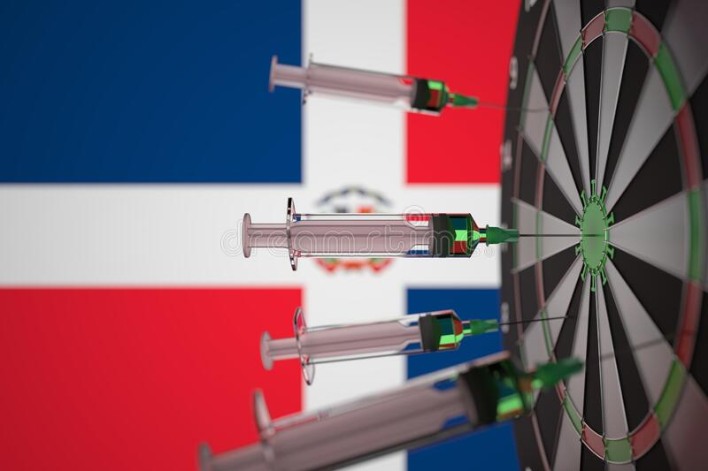 Coronavirus vaccine syringes on the Dominican flag background. Medical research and vaccination in the Dominican royalty free stock photo