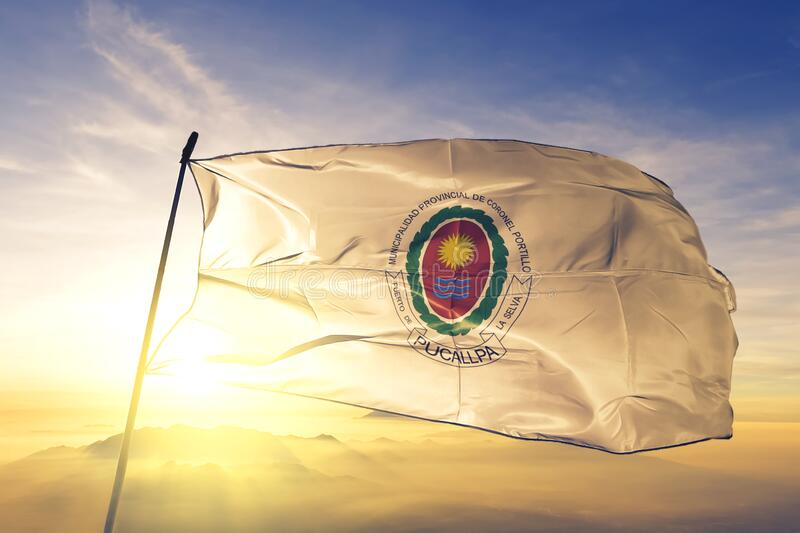 Coronel Portillo of Peru flag waving on the top sunrise mist fog. Coronel Portillo of Peru flag textile cloth fabric waving on the top sunrise mist fog stock images