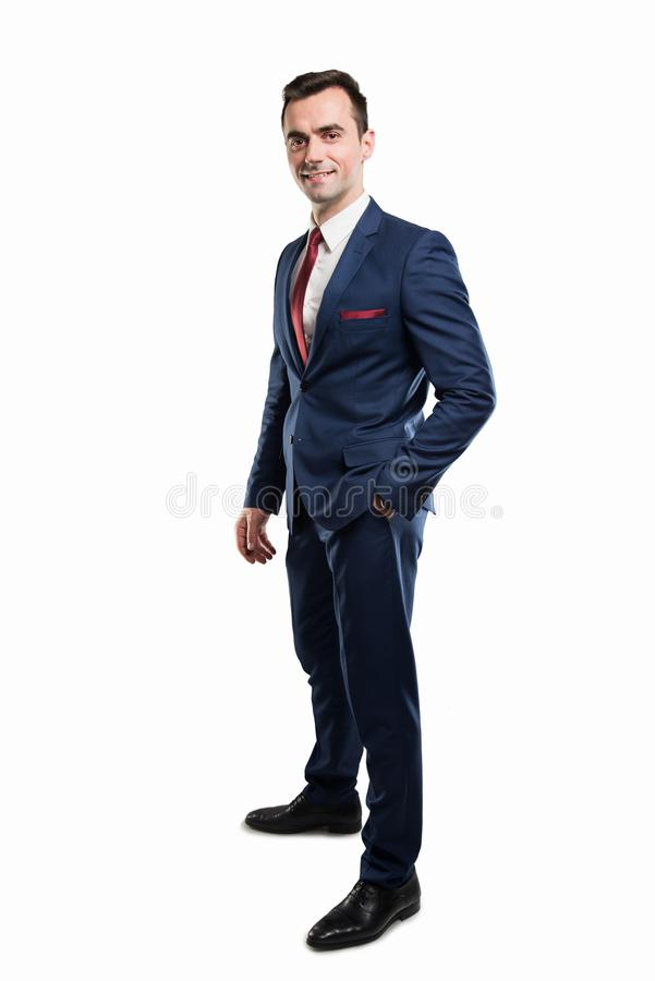 Corpo completo do homem de negócio atrativo que levanta o terno vestindo fotos de stock