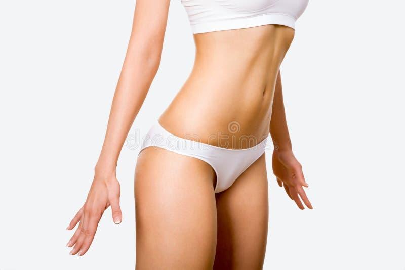 Corpo da mulher Tanned foto de stock