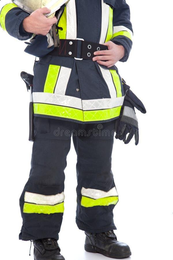 Corpo de um bombeiro que mostra seus uniforme e engrenagem imagens de stock royalty free