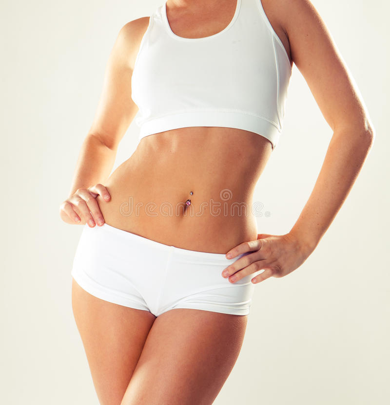 Corpo magro da mulher tanned. imagem de stock royalty free