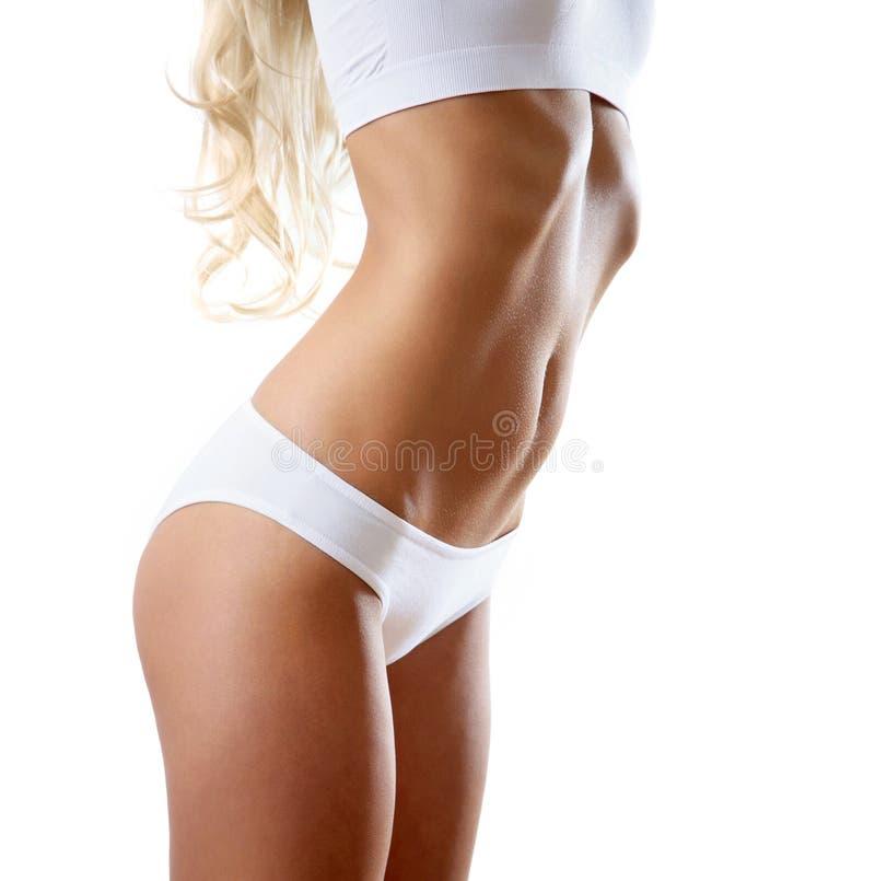 Corpo magro da mulher tanned fotos de stock royalty free