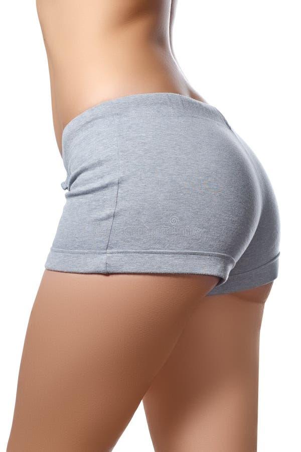 Corpo magro da mulher tanned Isolado sobre o fundo branco A parte traseira 'sexy' da mulher Cuidado do corpo da mulher Corpo fême fotos de stock