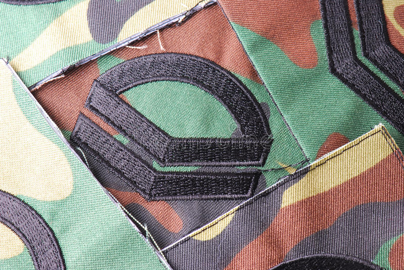 Corporal Rank Insignia. A photo taken on some corporal rank sew on insignia royalty free stock photo