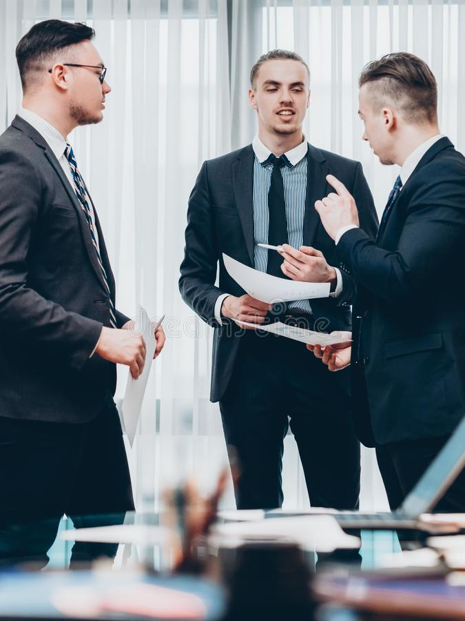 Corporate briefing male colleagues project terms royalty free stock photo