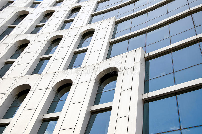 Corporate building. Corporate office building with large, glass windows royalty free stock photo