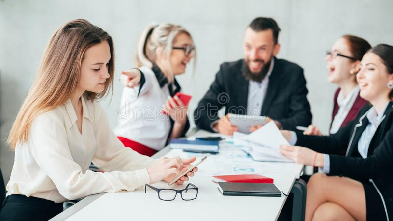 Corporate bullying business team meeting colleague. Corporate employees. Bullying and mocking. Business team meeting. Woman point finger at upset colleague stock image