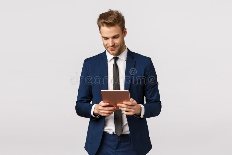 Corporate, business and finance concept. Handsome confident and elegant young bearded blond man, male entrepreneur stock photo