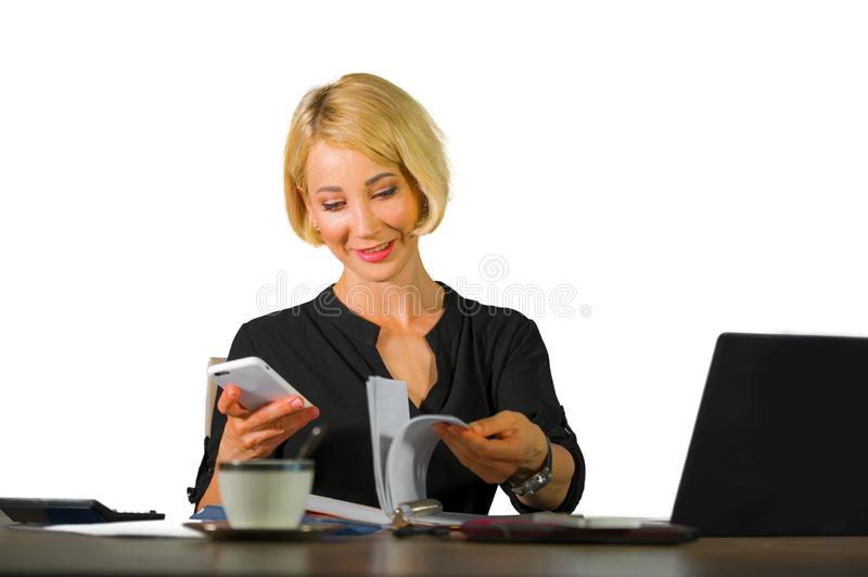 Corporate business portrait of young beautiful and happy woman with blonde hair smiling while working relaxed at office laptop com stock images