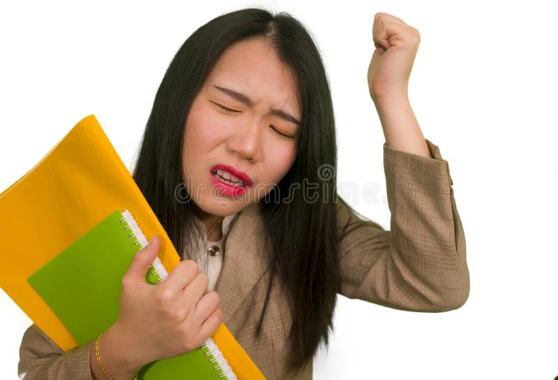 Corporate business stress portrait of young attractive upset and stressed executive Asian Korean woman tired and unhappy holding. Paperwork overwhelmed and stock images