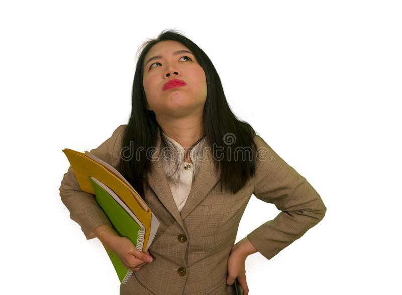 Corporate business stress portrait of young attractive upset and stressed executive Asian Korean woman tired and unhappy holding. Paperwork overwhelmed and royalty free stock photos