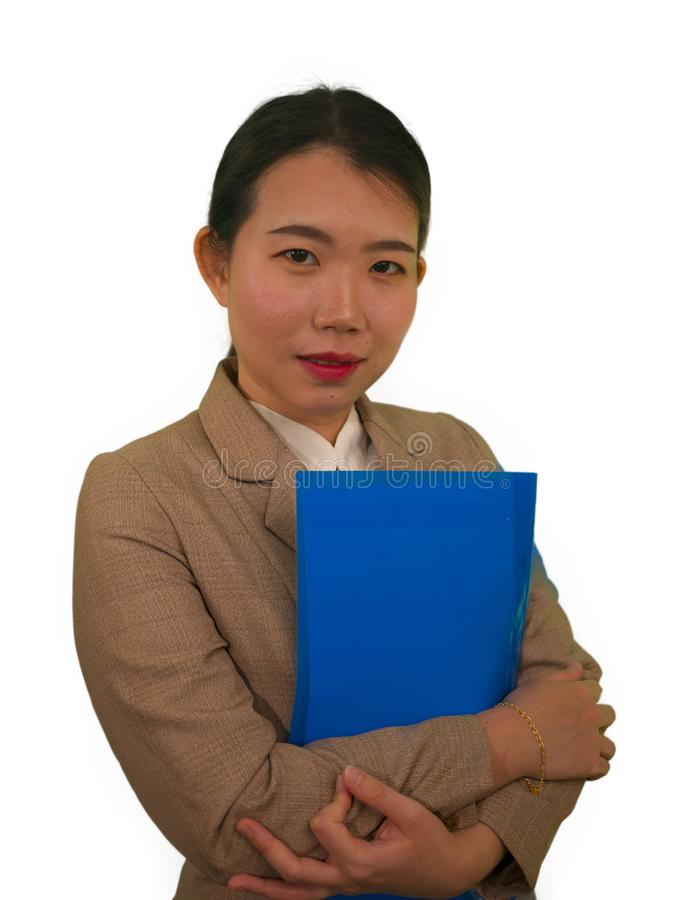 Corporate business success portrait of young attractive happy and confident executive Asian Chinese woman holding paperwork folder. Smiling cheerful in stock images