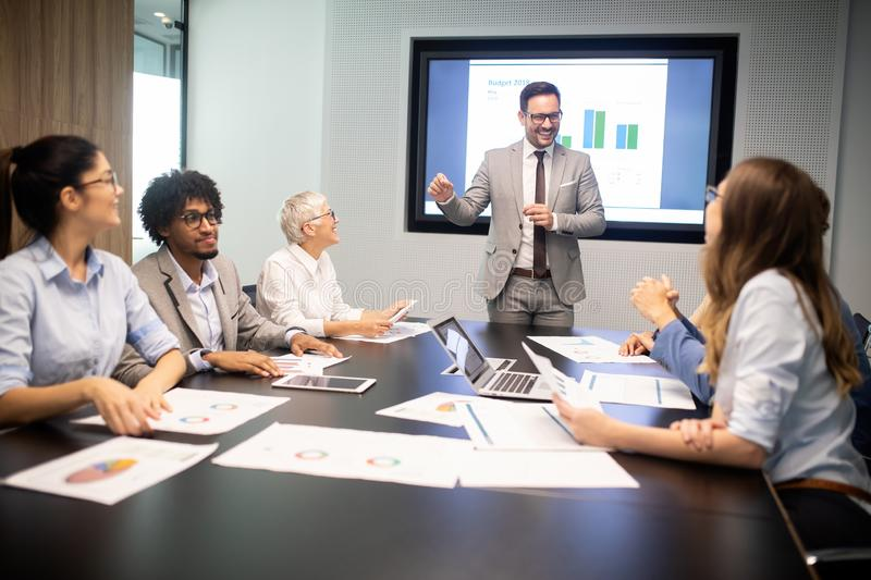 Corporate business team and manager in a meeting stock photography
