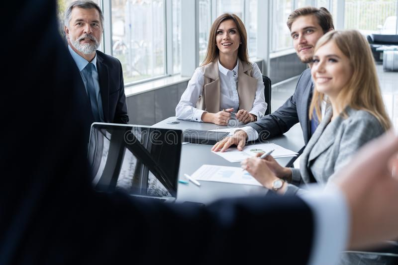 Corporate business team and manager in a meeting, close up royalty free stock images