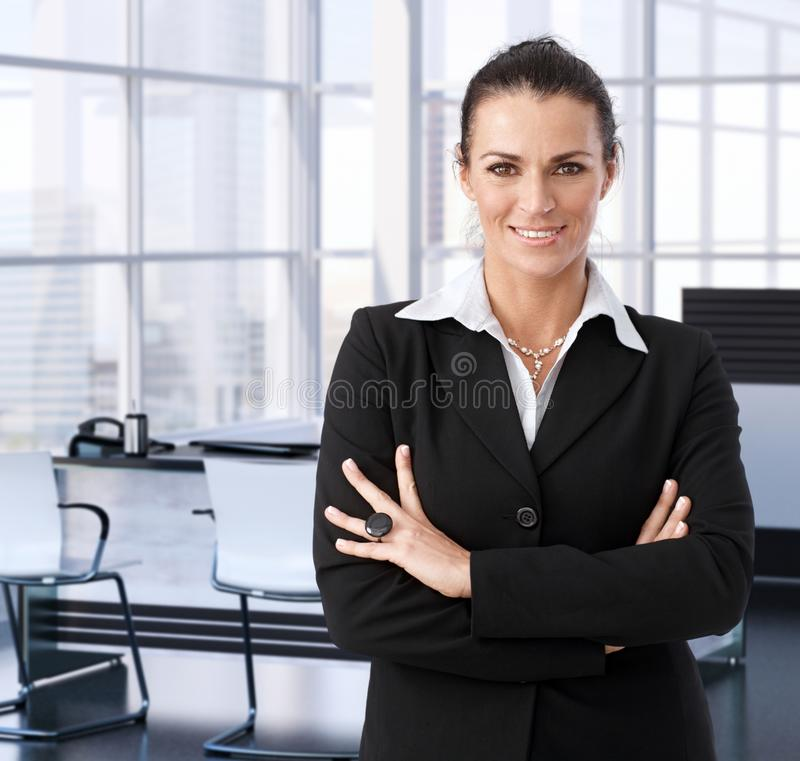 Corporate businesswoman in executive office royalty free stock images