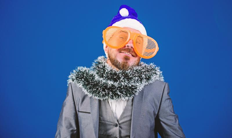 Corporate christmas party. Man bearded hipster wear santa hat and funny sunglasses. Christmas party organisers. Guy stock image